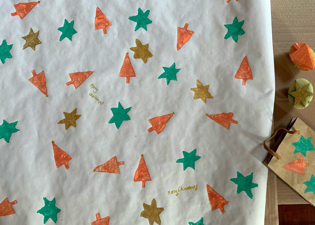 Decorating my own wrapping paper, an activity from The Nature of Play handbook