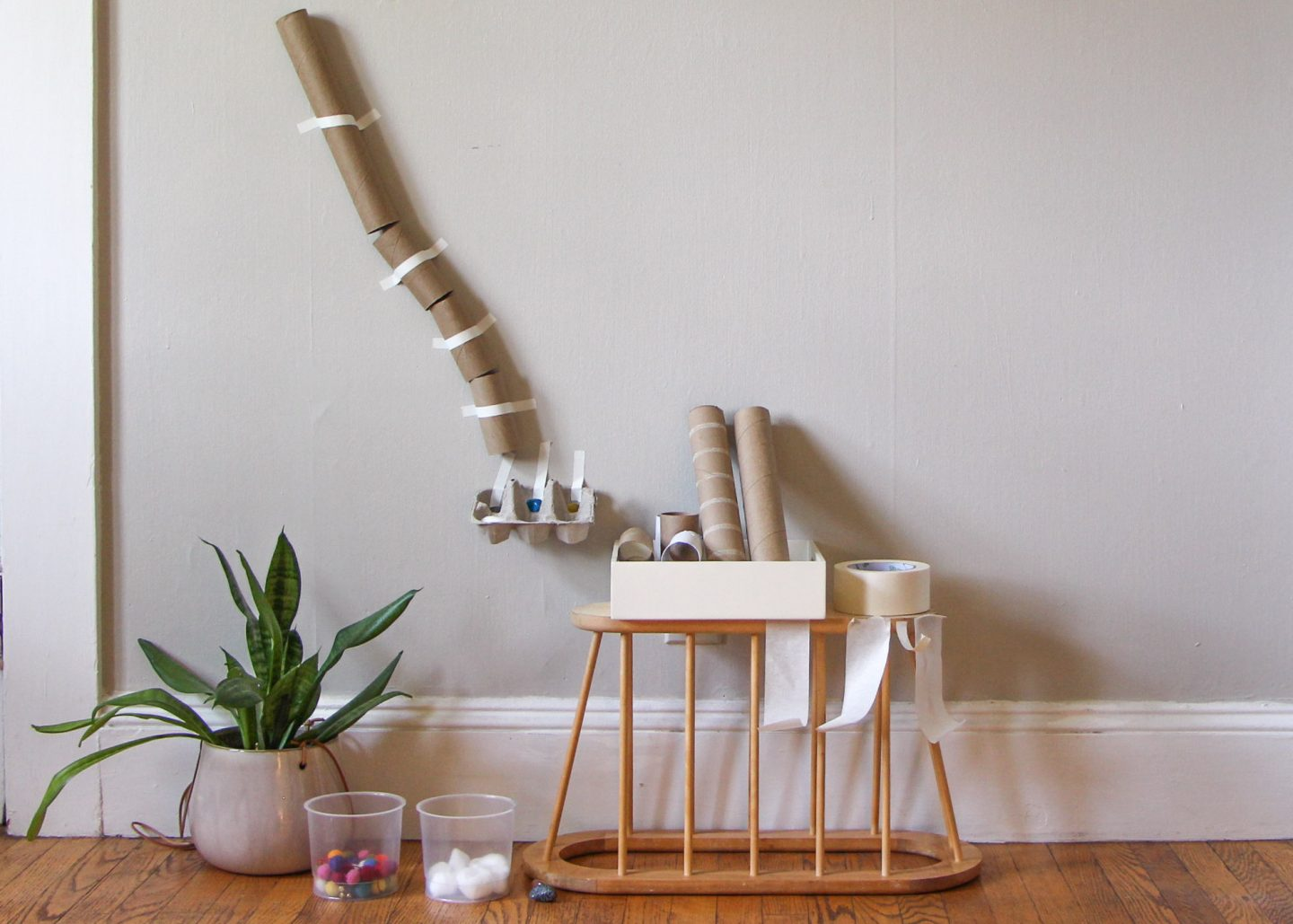 A marble run for toddlers made with recycled materials